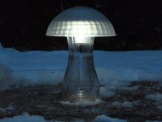Easy to make, and spectacular at night - a glass vase, and a bowl upside down over it hides the solar light, while allowing it enough light to charge the batteries....