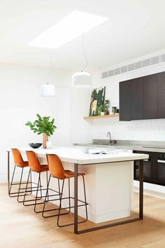 white kitchen with subway tiles and leather bar stools Subway Tile Kitchen, Subway Tiles, Kitchen Decor, Kitchen Design, Kitchen Trends, Kitchen Ideas, Leather Bar Stools, Cool Kitchens, White Kitchens