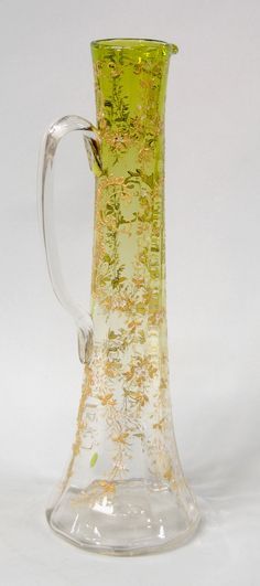 A Moser citron to clear glass ewer havingoverall gilt and enamel floral decoration with applied handle circa 1880 Czechoslovakia