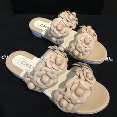 Chanel Camellia Sandals New chanel sandals size 37. Soles are a little bit dirty due to customers try on in store. Come with box and dust bag.  trade CHANEL Shoes Sandals