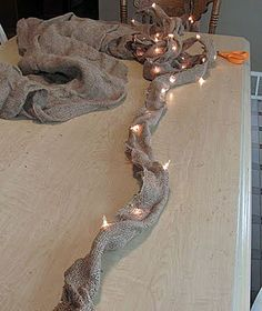 Pin for Later: 23 Unique Ways to Decorate With Christmas Lights Burlap Garland Create a beautiful DIY burlap garland by sewing a strand of Christmas lights into a large piece of burlap. Primitive Christmas, Noel Christmas, Country Christmas, All Things Christmas, Winter Christmas, Burlap Christmas, Christmas Mantels, Crochet Christmas, Office Christmas
