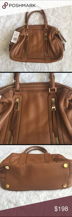 💯Michael Kors Julia LG Satchel in Brown Leather💯 💯💯💯Michael Kors Julia LG Satchel in soft brown leather with gold hardwares. Purse still has tag attached but I would consider it in excellent pre-loved conditions with minor signs of wear. It is however completely clean inside and outside, from Pet free smoke free home. ❌ trade. This bag is still currently listed at Major department stores for $348. Missing shoulder strap. All reasonable offers welcome. Thank you 💯💯💯 Michael Kors Bags…
