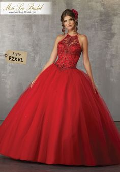 Style FZXVL Crystal Beaded Bodice on a Tulle Ball Gown The Perfect Mix and Classic and Modern, this Tulle Quinceañera Ballgown Features a Fully Beaded High Halter Bodice and Delicately Beaded Ballgown Skirt. Matching Stole Jacket Included. Colors Available: Blush, Red, Wine, White