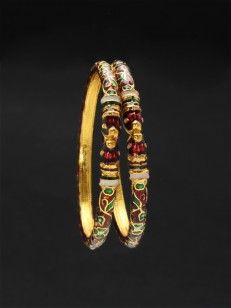 Red enamel bangles with floral design