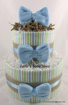 Listing is for this blue diaper cake in a Bow ties and Burlap theme  Contents:  45 Disposable diapers (size 1) 2 Receiving blankets (30 x 30 inches) 3 Infant washcloths 1 9 oz bottle   Your baby shower decoration will arrive wrapped in tulle, adorned with matching ribbons - Ready for displaying! This unique diaper cake measures 10 inches at the base and stands 12 inches in tall.  Have you looked at our other baby diaper cake options? https://www.etsy.com/shop/MsCarlasBabyCakes  Not what you…
