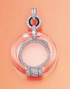 A diamond, rock crystal and onyx lorgnette, by Cartier. The rose-cut diamond framed glasses fold into a rock crystal case with single-cut diamond and pearl detail to the circular diamond and onyx surmount suspended from a diamond-set pendent hoop, circa 1923, with French assay marks. Signed by Cartier, Paris, Londres, New-York.
