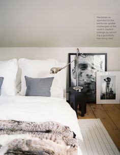 White bed linen, faux fur throw, black & white pictures, wood floor #neutral #white #bedroom
