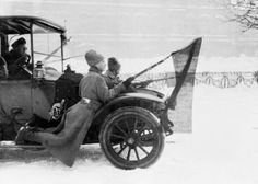 Mutinous soldiers riding on an automobile during the uprising of the Petrograd garrison, 1917. Photo by Roger Viollet.