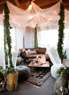 An ethereal canopy encloses an intimate lounge area that looks as if it's…