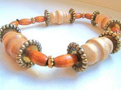 Bracciale elastico perle di legno color avorio e di LeSirenes, €8.90