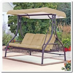 Outdoor Patio Swing w/ Canopy. Adjusts to Hammock Position. Update the Patio Furniture. This Over Sized Porch Swing Seats 3 Comfortably While Sitting in the Shade with the Overhang Awning. This Outdoor Swing Matches Any Patio Table and Chair Sets.