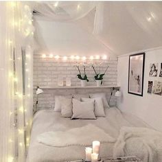 Create an elegant statement in your bedroom with a white brick wall along with a snow-white bed and pillows to give you the perfect place to get a wonderful nights sleep.