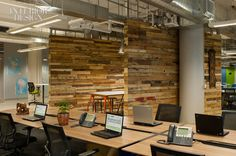 Open plan office with nice wood partition wall! #openplanoffice Cubicles.com