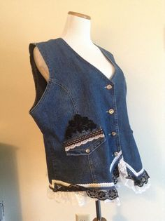 Here's what can be done to an old denim vest: add some lace trim & enjoy wearing your upcycled creation.