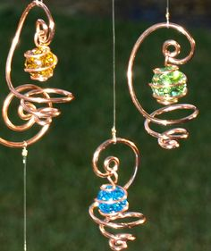 Solid Copper Glass Mobile Suncatcher Handcrafted by TwistsOnWire. $34.00, via Etsy.