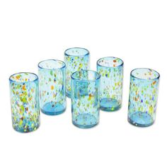 This handmade creation is offered in partnership with NOVICA, in association with National Geographic. Sky blue tumblers are wildly speckled with multiple colors in a set of drinking glasses by Javier