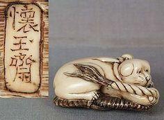 19c netsuke PUPPY on sandal by KAIGYOKUSAI MASATERU -  Masateru, whose more common signature is KAIGYOKU MADO MASATERU (Kaigyoku's grandson, Masateru