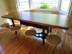 """Custom fabricated vintage industrial lunch table complete with swing out swivelling stools. Raised steel lettering on the cross beam which reads """"TOLEDO STOOL COMPANY"""". The top is a vintage 8 foot long butcher block."""
