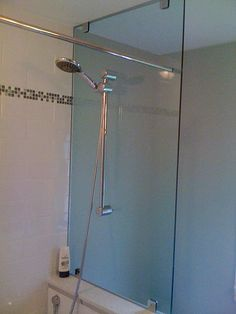 Shower rod and head mounted on glass