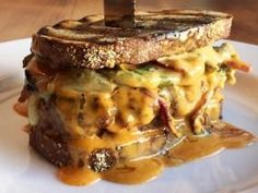 "Animal - The only one that's offered, the off-menu Boner Burger ($16), ""ain't your mama's burger, but it is yummy."""