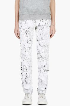 MCQ ALEXANDER MCQUEEN White Cracked Paint Jeans