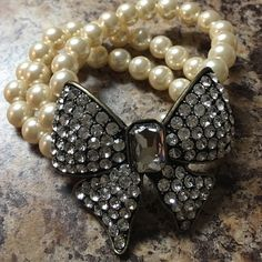 Pearls and bling! Rhinestone bow and pearl bracelet. Forever 21 Jewelry Bracelets