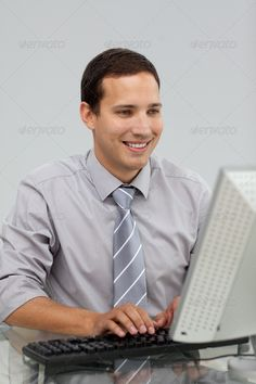 Charming young businessman working at a computer ...  adult, attractive, background, beautiful, boss, boy, business, businessman, busy, caucasian, color, communication, computer, confident, cute, desk, happy, internet, keyboard, leader, male, man, manager, modern, monitor, notebook, office, people, person, portrait, pretty, professional, representative, secretary, sitting, smile, successful, table, technology, white, work, worker, workplace, young