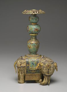 Figure of an Elephant with Two Miniature Vases  Cloisonné enamel on copper alloy Place  China Dates: 18th century  Qing Dynasty