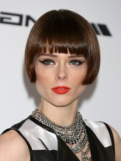 Coco Rocha sported a chic brunette bob cut with blunt bangs at the Cinema Against AIDS Gala. Description from stylesweekly.com. I searched for this on bing.com/images