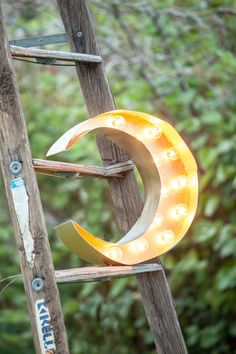 Golden Crescent Moon. Made of foam core, poster board and globe lights. $15 total. W/ dimmer switch $27. www.facebook.com/lovelyluminaries