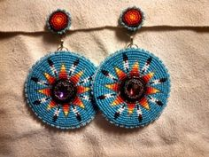Commissioned beadwork. Beaded rosettes using sz 13 cut Charlottes,  Toho Japanese beads, and Swarovski Rivoli crystals.