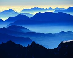 The mountains of the Écrins range are cloaked in dawn mist above the commune, or borough, of Briançon.