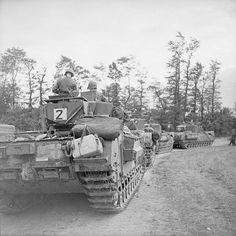 Churchill tanks of 7th Troop, 'B' Squadron, 107th Regiment Royal Armoured Corps, 34th Tank Brigade. Normandy, 17 July 1944.