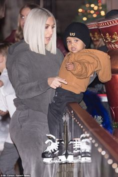 Happy family: Kim looked delighted to be spending time with her toddler son Saint...