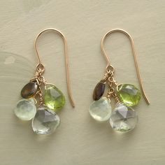 """CELEBRATION EARRINGS--Bubbly splashes of faceted green tourmaline, peridot, prehnite and green amethyst create a gala world of translucent hues in Thoi Vo's breathtaking earrings. 14kt goldfill. 1-1/4""""L."""