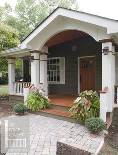 beautifully designed front porch with hip and gable roof. The Craftsman front door is a perfect fit.