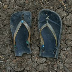 These shoes belong to Makka Kalfar, an 8-year-old refugee girl who walked for 20 days in these shoes. She cut them to feet her.
