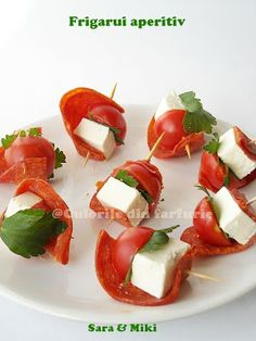 salami and cheese appetizers Ingredients: * Sliced salami as dry * Cherry tomatoes * Cheese (goat, mold, feta ...) * Leaf parsley * Toothpicks