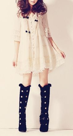 I really like this. The dress is dainty and delicate with really cute lace and detailing, while the boots are both prominent and feminine : )