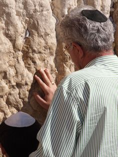 Generations together in prayer at Jerusalem's Western Wall.