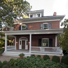 A red brick house with white trim and detailing, and a big beautiful porch...three of my favorite things!!... oh my goodness