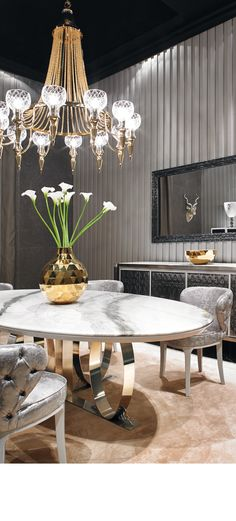 Luxury silver table. Modern chandelier. Luxury interior design. For more inspirational news take a look at: www.aussieliving.net