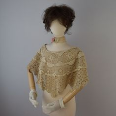 This layered shrug bridal shawl features two layers, a fine crochet bottom piece and a top of vintage Tuscan lace. They are attached at the