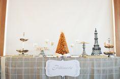 This elegant dessert table balances the Parisian theme perfectly.