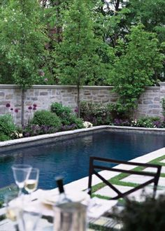 Stone wall behind pool