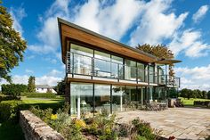 An award winning contemporary self-build home in Monmouthshire that combines organic materials such as stone and cedar with contemporary glazing to create a modern, yet rural, home