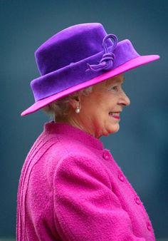 Britain's Queen Elizabeth II arrives to view the world's biggest passenger liner, the Queen Mary 2 at her home port January 2004 in Southampton, England. The Queen officially named the Get premium, high resolution news photos at Getty Images Fuchsia, Pink Purple, Purple Haze, God Save The Queen, Fashion Through The Decades, Decades Fashion, Queen Hat, Foto Real, Isabel Ii