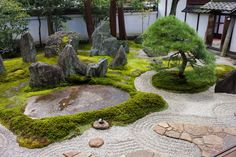 "The garden at the Shigemori House Museum, showing a stepping-stone path across the raked gravel and moss landscape. On the day McKellar visited, the path was blocked by a stone wrapped in black twine (tome-ishi 止め石 ""stop stone""). The concrete pathway that penetrates the expanse of raked gravel in the Harn garden becomes less jarring after seeing other dry landscapes with pathways. (MM)"