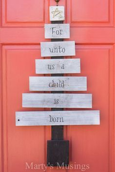 Want a unique option to the ordinary front door wreath? DIY blogger Marty's Musings shares her creative scrap wood Christmas tree made from old fence boards, some spray paint and vinyl lettering.