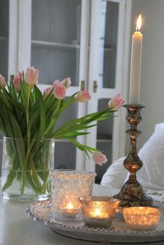 Love this simple vignette design with a tray and tulips. Create the same look the safe way with Candle Impressions flameless tea lights, votives, and tapers!